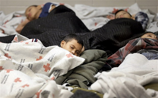 Illegal Children Immigrants sleep in the cramped quarters of the temporary housing set up by the Obama Administration.   Photo from telegraph.co.uk