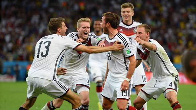 The winning German team looks jubilant as they realize their victory.