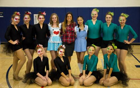 Ms. Maes and her Dance Co. team pose for a photo before their 2014 Homecoming Rally performance.  Photo courtesy of Kyle Stevens, via ylhsdancecompany.com.