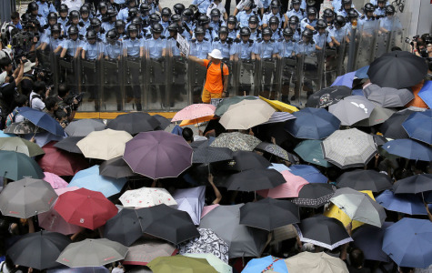 The Hong Kong protestors flood the streets using umbrellas to cover their faces from pepper spray.