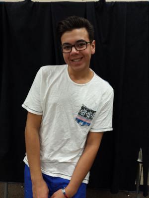 Gavin Gondalwala, the Junior Prince, smiles at the camera.