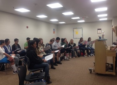 Choir, consisting of Vocal Ensemble and Concert Choir, practice songs during 0 period.