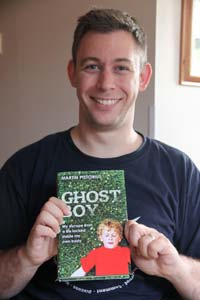 Martin pictured with his book, Ghost Boy.  Photo courtesy of martinpistorius.com