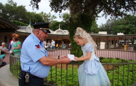 Photo courtesy of huffingtonpost.com    The security guard at Magic Kingdom has an autograph full of children's autographs to make them feel like princes and princesses.
