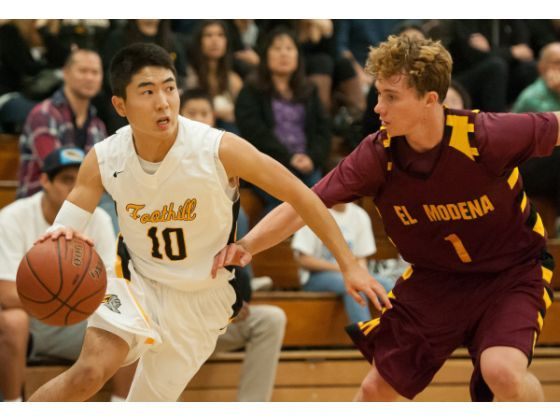 Photo courtesy of ocvarsity.com   Reed Nakakihara, Foothill High School basketball player, remains unaffected by the racial slurs thrown at him during the Esperanza vs. Foothill basketball game.