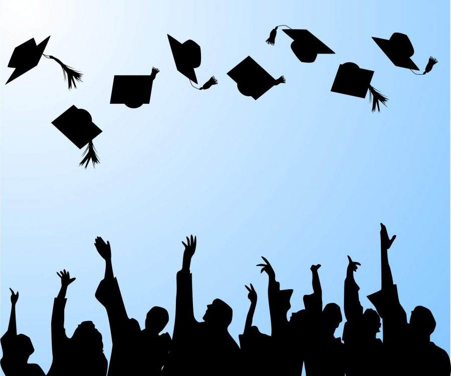 A+traditional+cap+tossing+ceremony+at+graduation.+