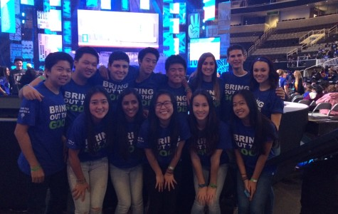 The 13 We Day attendees pictured in front of the We Day stage on February 25, 2015