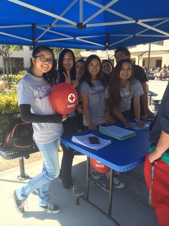 Campus+Blood+Drive+Committee+members+show+their+support+during+lunch+by+signing+donors+up.