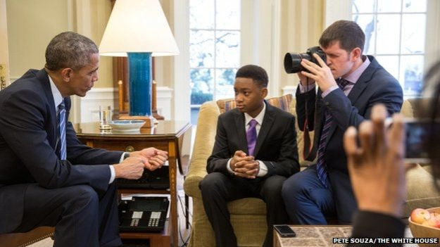 Brandon Stanton, founder of HONY, and Vidal, the boy who inspired Stanton's 2015 Indiegogo campaign for Mott Hall Bridges Academy, are depicted here with President Obama.