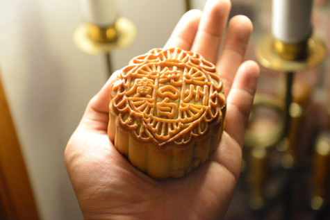 A traditional moon-cake filled with a sweet paste of lotus beans.