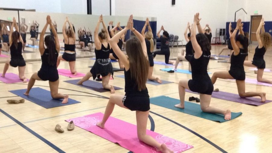 Advanced Dance enjoying a relaxing yoga Monday.