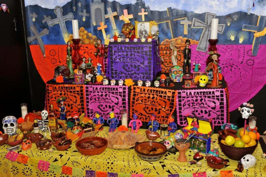 An example of an Altar on Dia de los Muertos. Photo Courtesy of UVC Blog.
