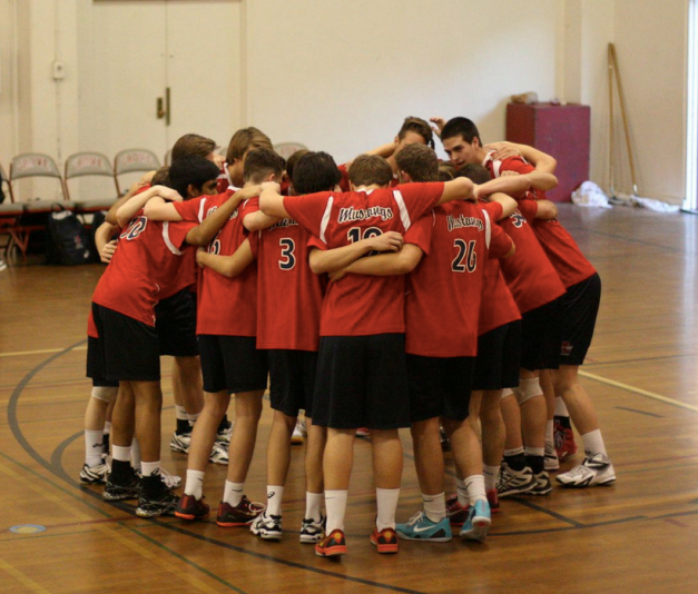 Men's Varsity Volleyball huddled together discussing their plan for the game. Photo Courtesy YLHSmensvolleyball.com
