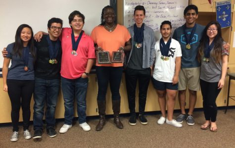 The YLHS Academic Decathlon team posing with advisor, Ms. Stephenson, and their awards from the competition.