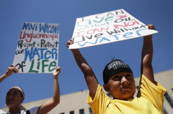 Omaka Nawicakinciji, 7, of the Oglala Lakota Nation in South Dakota, protests the Dakota Access pipeline alongside his mother, Heather Mendoza, in Washington.