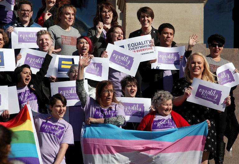 Members of the LGBT+ community rally on the steps of the State Capitol in Pierre, S.D., for Trans Kids Support Visibility Day in February.