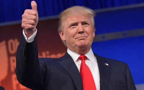 Donald Trump gives a thumbs-up.