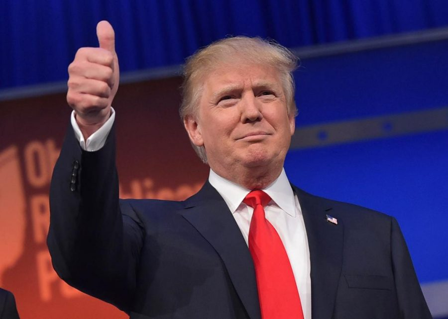 Donald Trump gives a thumbs-up.