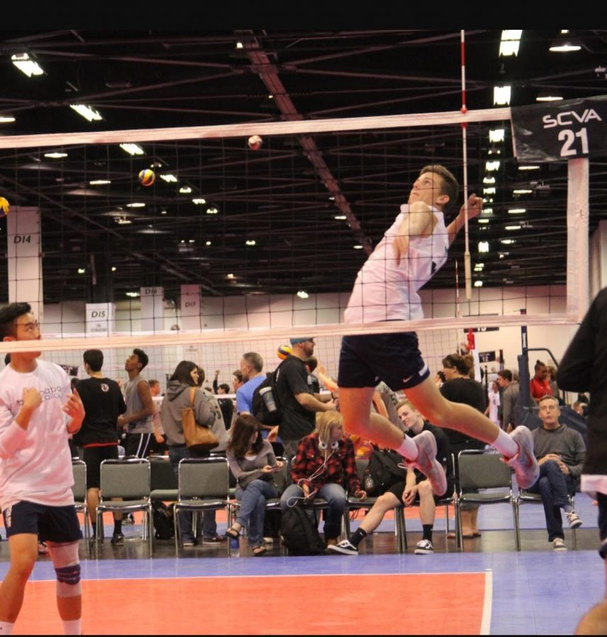 Photo courtesy of YLHS Men's Volleyball. Mason going in for the ball at a volleyball tournament.