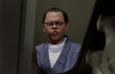 Mickey Rooney mocks Asian Americans by using yellow face to portray a Japanese man.
