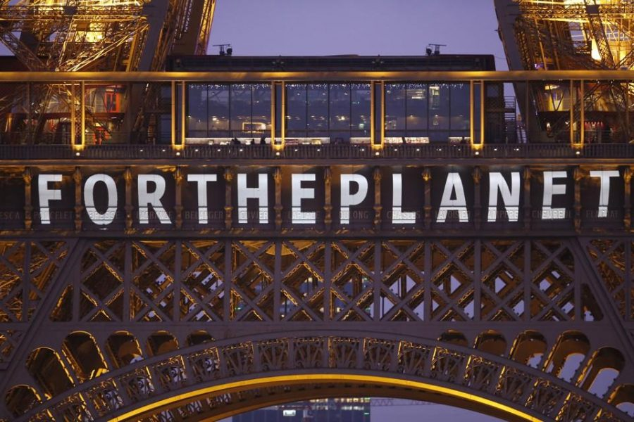 The+slogan+%22For+the+planet%22+is+projected+on+the+Eiffel+Tower+as+part+of+the+World+Climate+Change+Conference+2015++