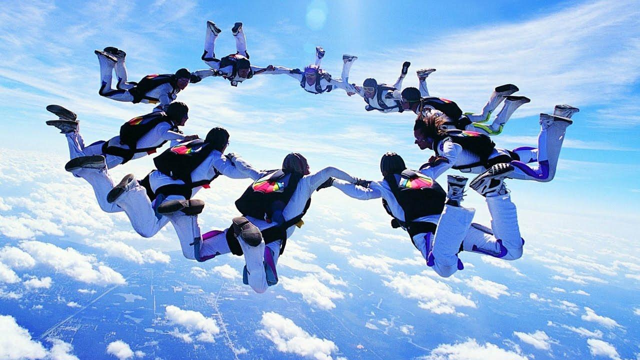 A group of athletes enjoying the thrill of skydiving. https://www.youtube.com/watch?v=YNxrOnKA0Sg