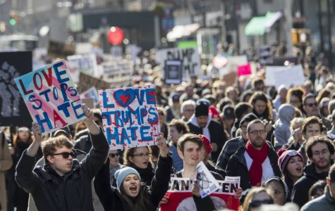 Demonstrators chant slogans as they march up Fifth Avenue in New York during a protest against the election of President-elect Donald Trump, Nov. 12, 2016.