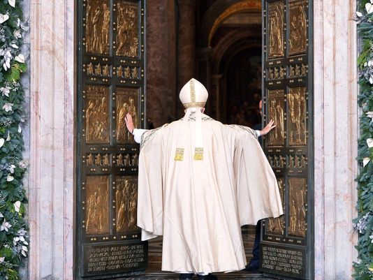 Pope Francis blessing the Holy Door of the Year of Mercy