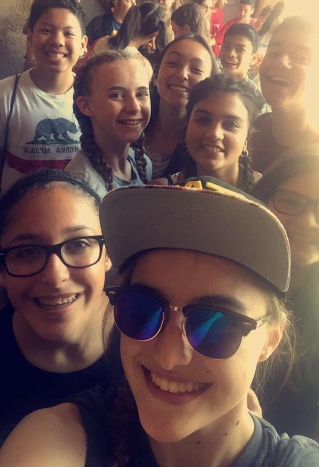 Photo of Grace Brisco, Malieka Khan, Trevor Secoda, Stephen Serrano, Emily DiBias, Polly B., Alexis T., Emelia O., and Nick Deang during their eighth grade trip to Knotts Berry Farm.
