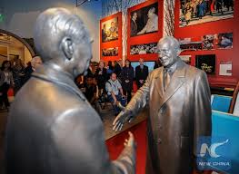 shows a shaking hands statue of Nixon and China's former Premier Zhou Enlai in the Richard Nixon Presidential Library.