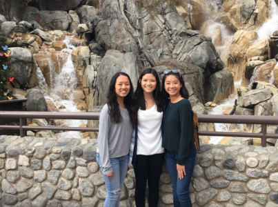 Katrina with her friends, Maddy Ho and Karissa Dole, at Disneyland for orchestra.