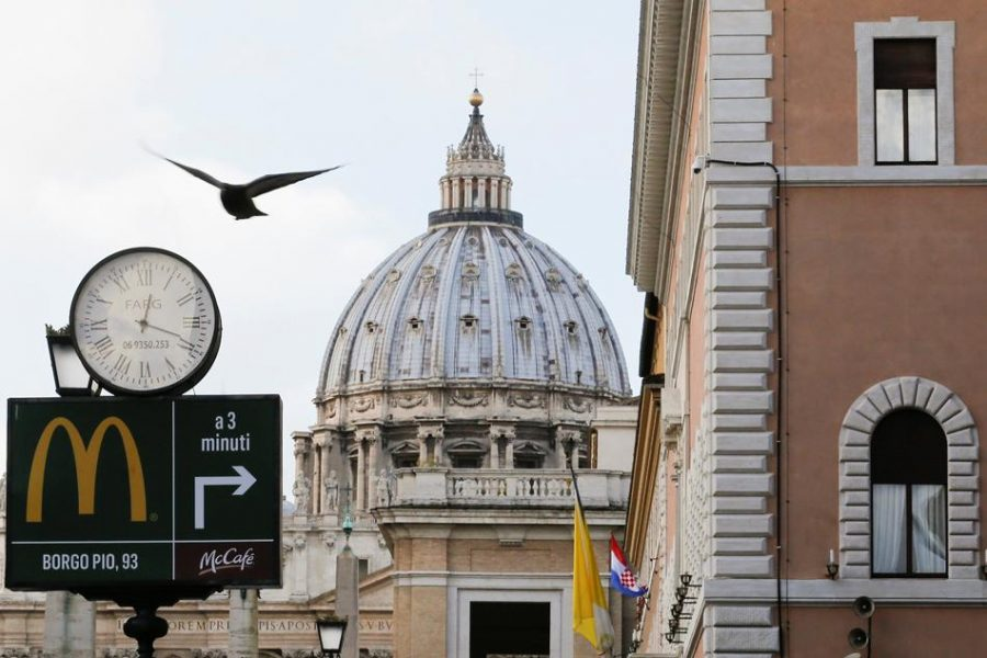 Photo Courtesy of news.abs-cbn.com // McDonald's sign is seen at Via della Conciliazione street in Rome, Italy in front of St. Peter's Basilica.
