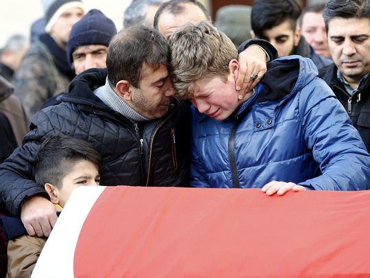 Relatives gather at the funeral of one of the victims, Ayhan Arik, to mourn their loss.