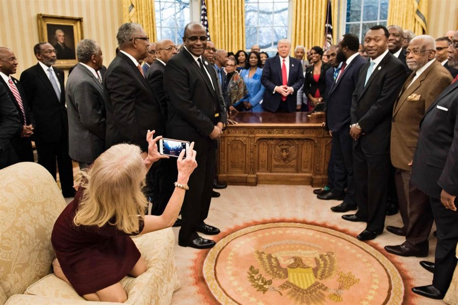 Kellyanne+Conway+is+sitting+improperly+on+the+couch+while+taking+a+photo+of+the+important+educators+and+the+president.