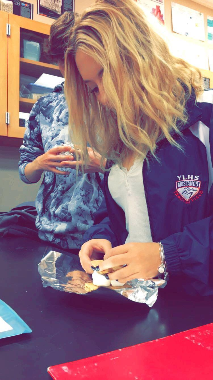 Hailey Denuccio (10) prepares her delicious s'more by wrapping it in Tin Foil to make it heat up faster.