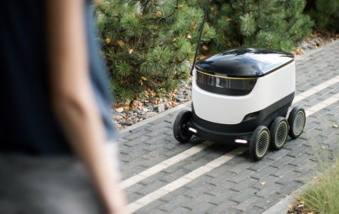 One of the DoorDash robots making a food delivery.