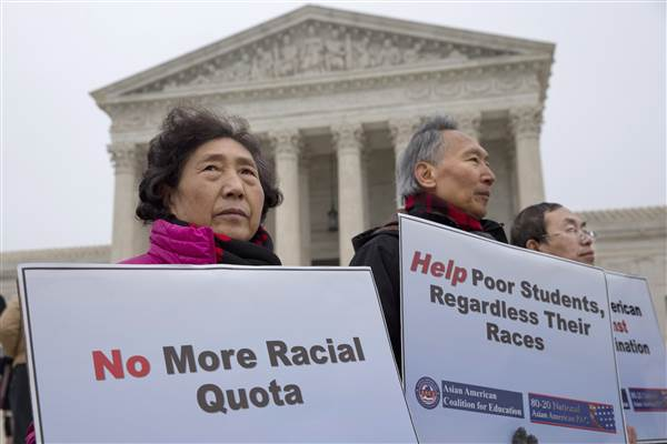 Asian Americans gather outside the Supreme Court to protest against Affirmative Action.