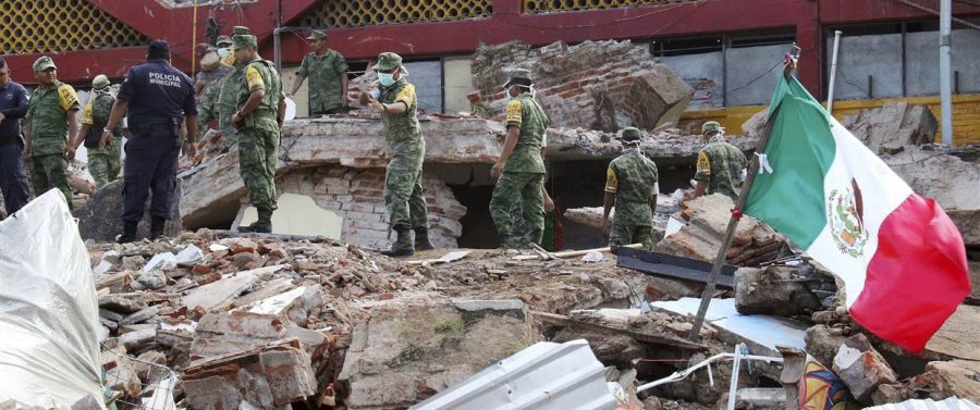 Soldiers checking out the rummage of the earthquake.