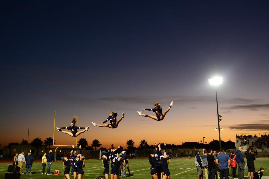 Mustang Cheerleaders support the Yorba Linda Football team at Fred Kelly Stadium under the Friday night lights.