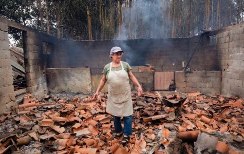 A woman seeing her property wrecked and burnt down