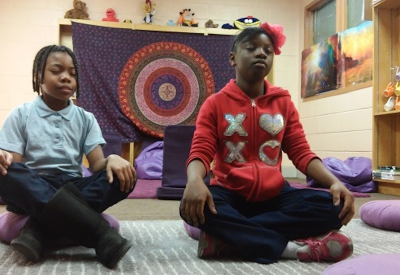 kids meditating in the Mindful Moment Room; photo courtesy of Inhabitat