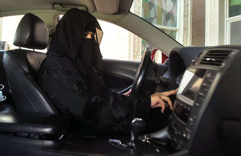 A+Saudi+women+happily+takes+the+wheel+in+2013%2C+unaware+she+will+be+able+to+legally+drive+within+only+a+few+years.