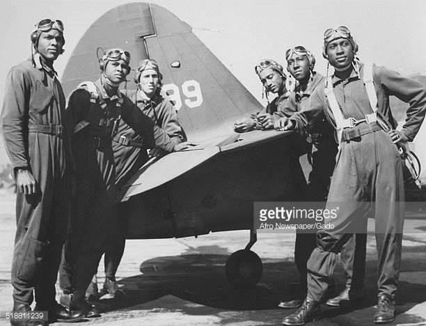 Tuskegee+Airmen+at+Tuskegee+Army+Flying+School+with+a+fighter+plane.+