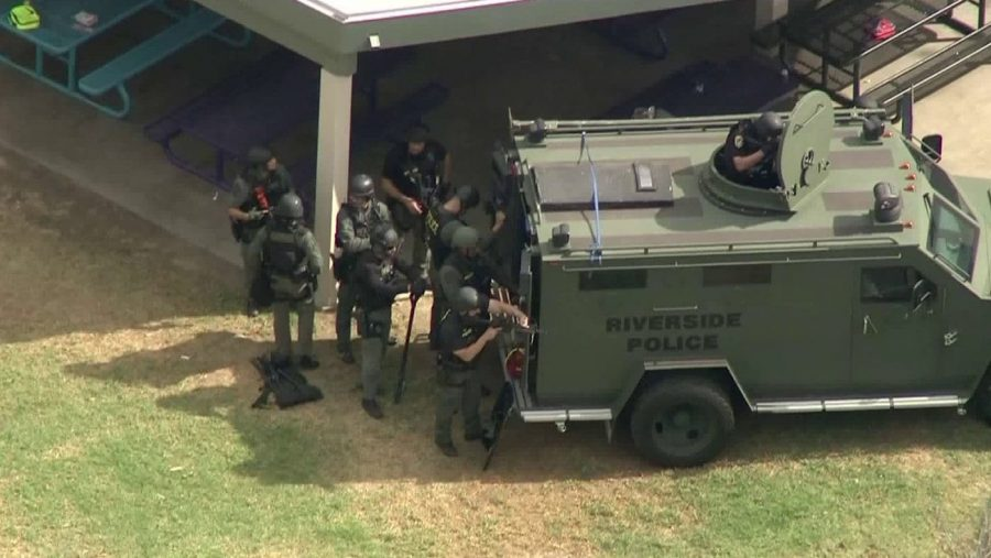 SWAT prepares to swarm classroom and rescue the hostage (photo courtesy of Washington Post).