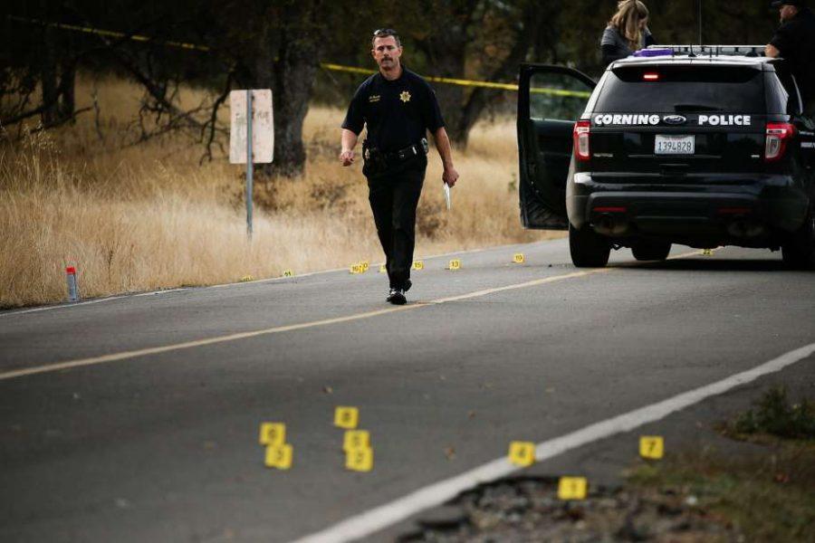 A police officer walks on the crime scene.