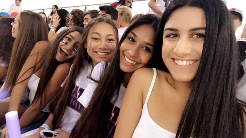 best friends sharing each others company at the YLHS vs Esperanza football game