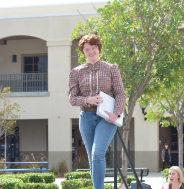 Kate Shepherd (11) walks down the runway as one of her favorite T.V. characters, Barb.