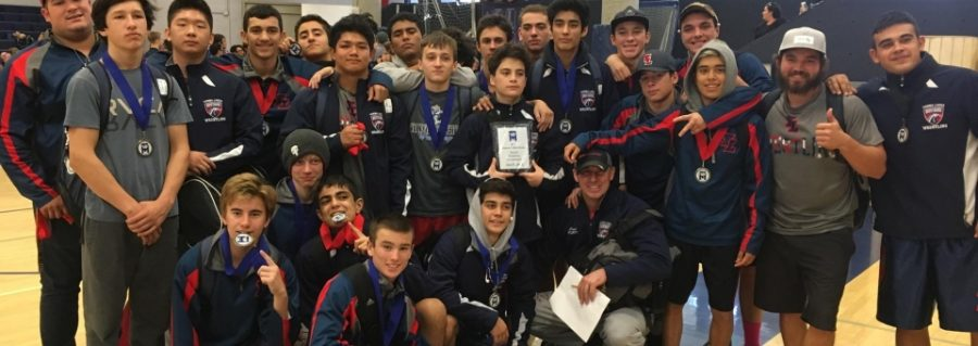 YLHS wrestlers are celebrating their win.  Photo credit: YLHS wrestling