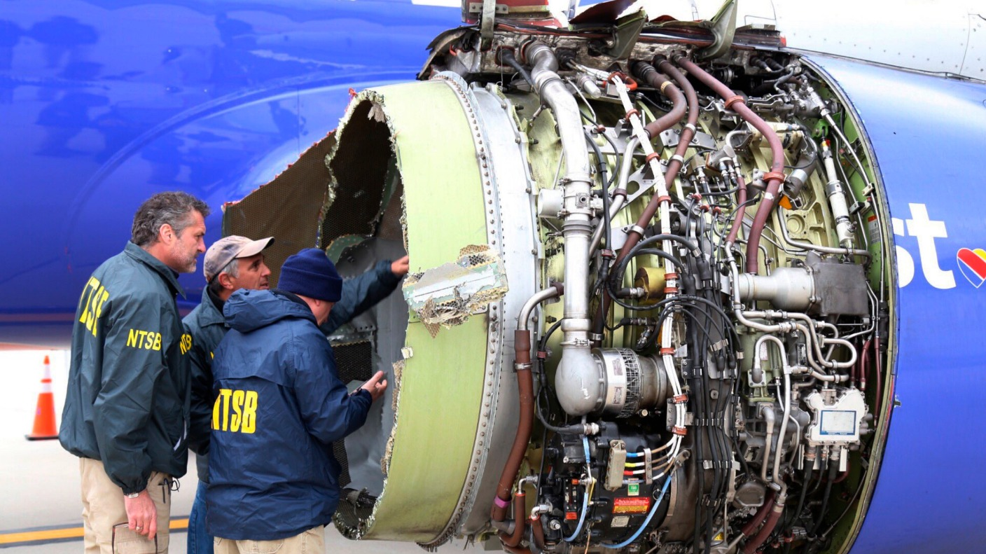 Below, the NTSB inspects the airplane engine after the emergency landing in Philadelphia. The busted engine was the main cause of Jennifer Riordan's death.