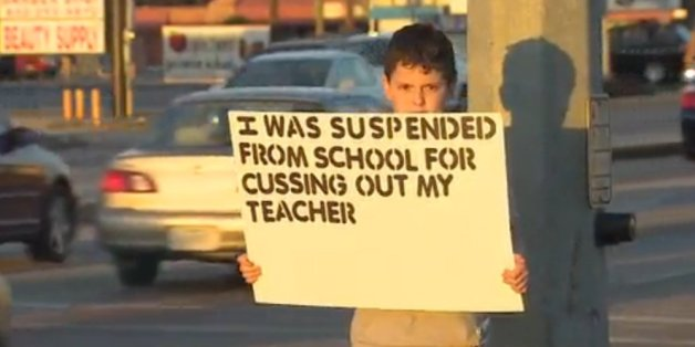 The boy in the picture was publicly humiliated after being suspended from school.  Photo credit: Huffington post